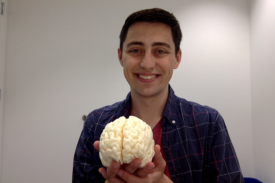 me holding a 3d printed copy of my brain